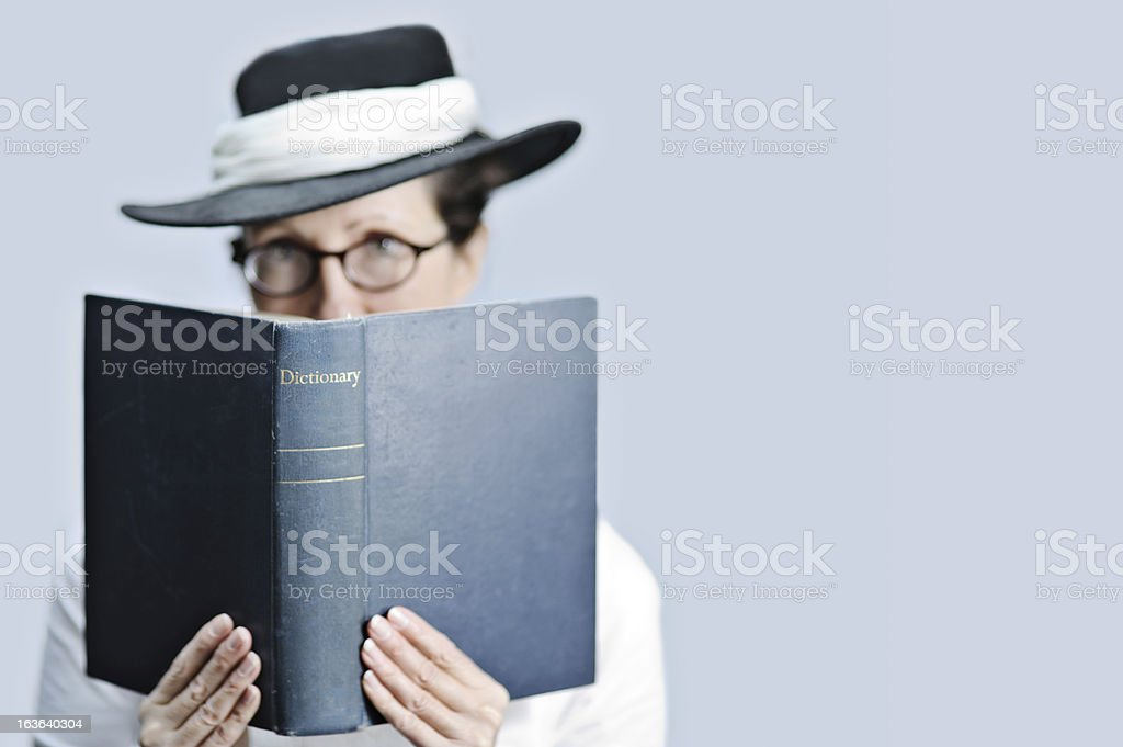 Strict teacher/librarian with dictionary stock photo