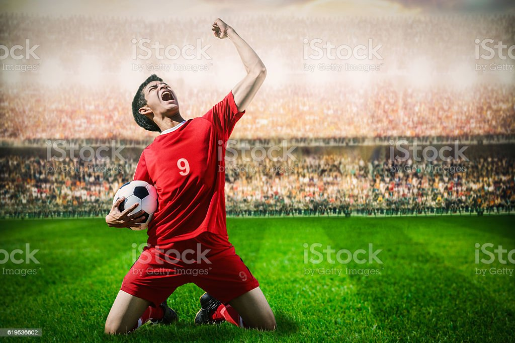 striker soccer football player in red team concept celebrating g stock photo
