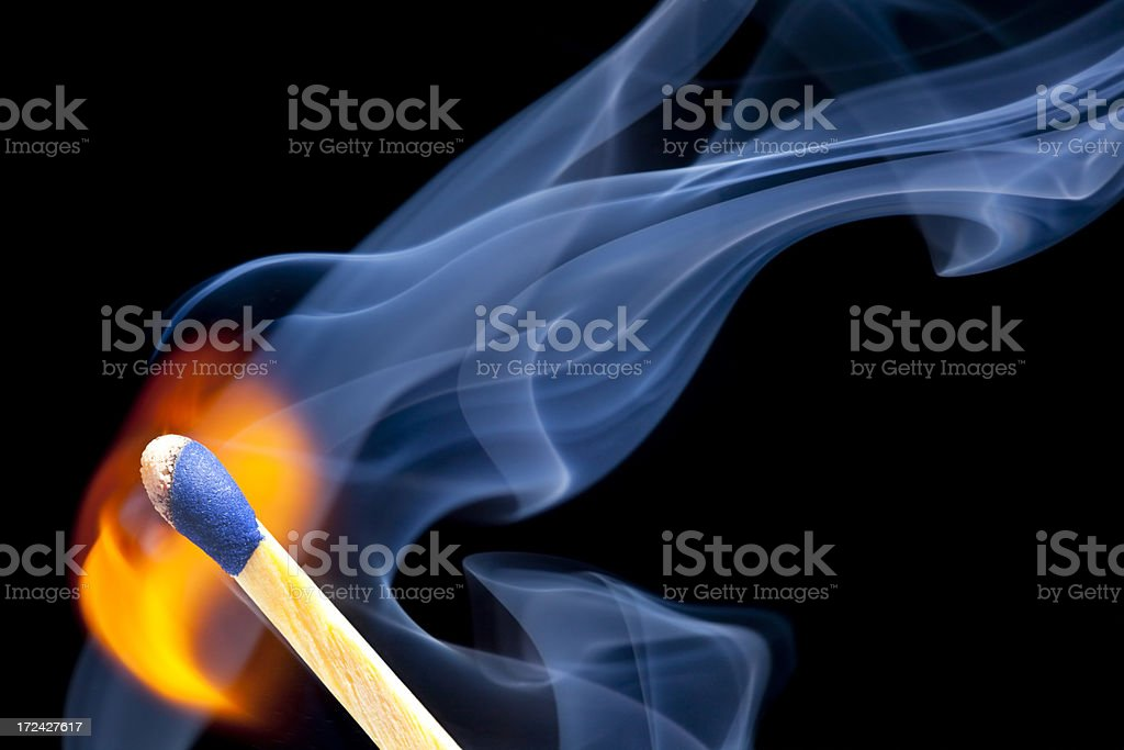 Striking a Match into Flame royalty-free stock photo