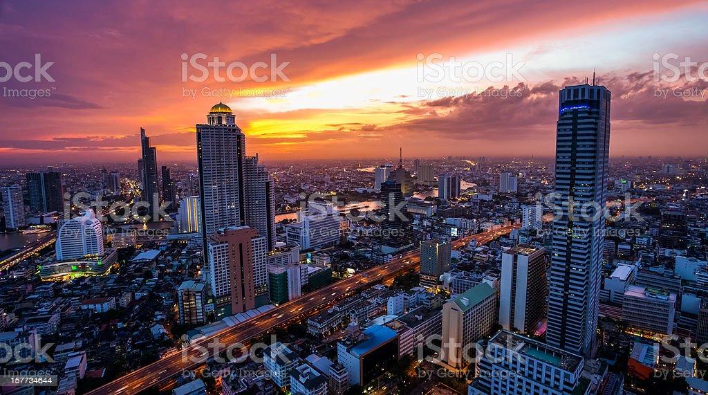 Striking Orange hued sunset over Bangkok royalty-free stock photo