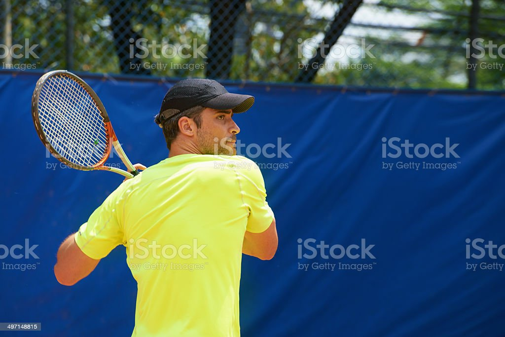 Striking the ball with conviction royalty-free stock photo