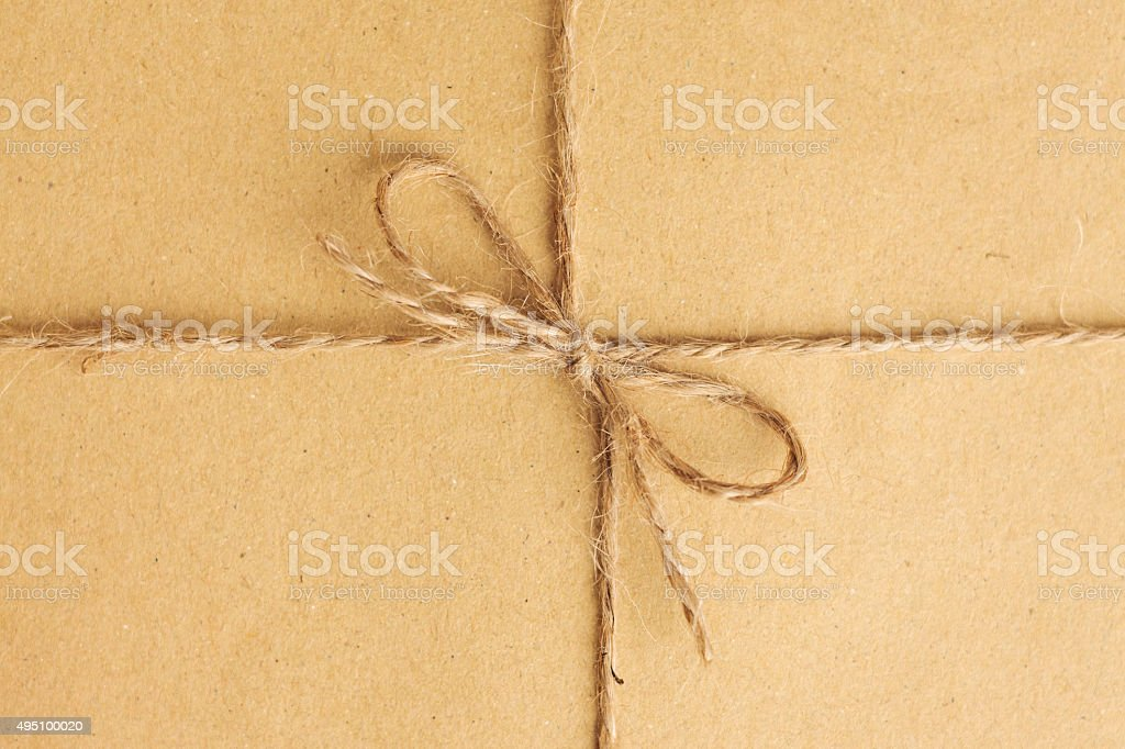 String bow on brown paper stock photo