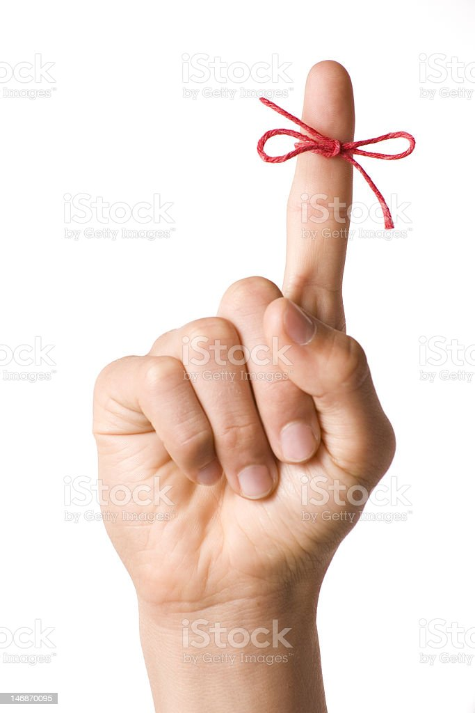 String Finger Reminder on White stock photo