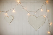 String lights and hearts hanging on wall