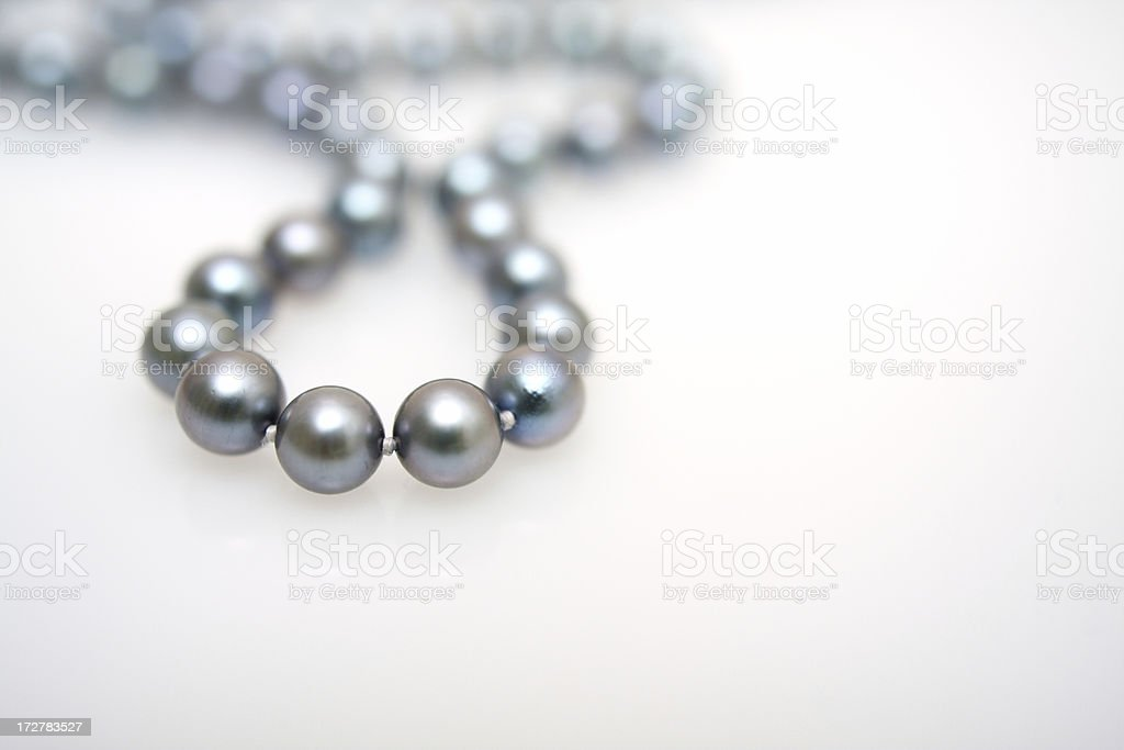 String of black pearls stock photo