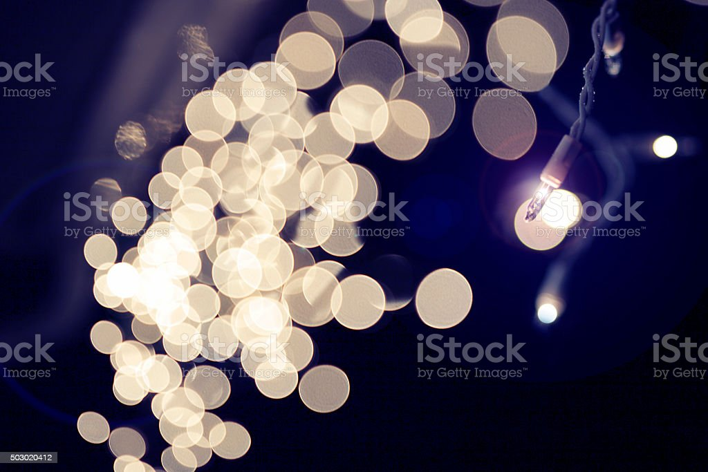 String of bright white holiday lights blurred stock photo