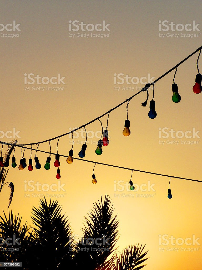 String of Lights and Palm Trees at Sunset stock photo