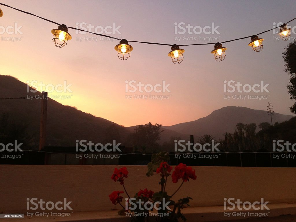 String of lights at sunset stock photo