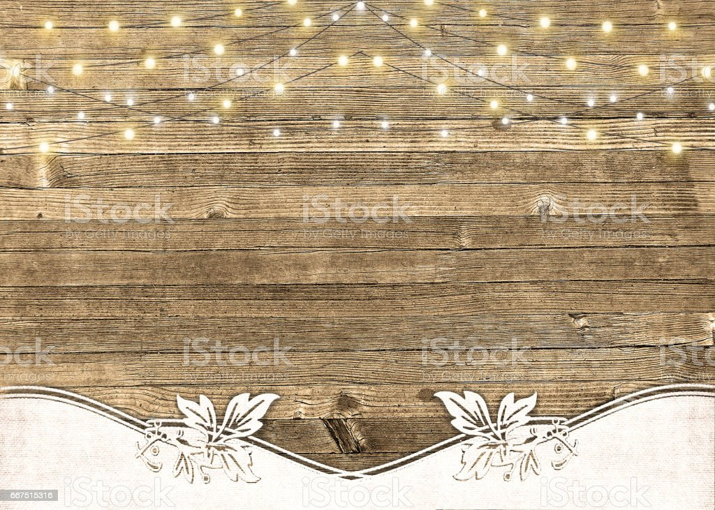 string of lights on rustic wood stock photo