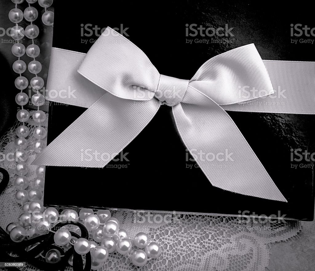 String Of Pearls With Elegant Gift Box Background stock photo