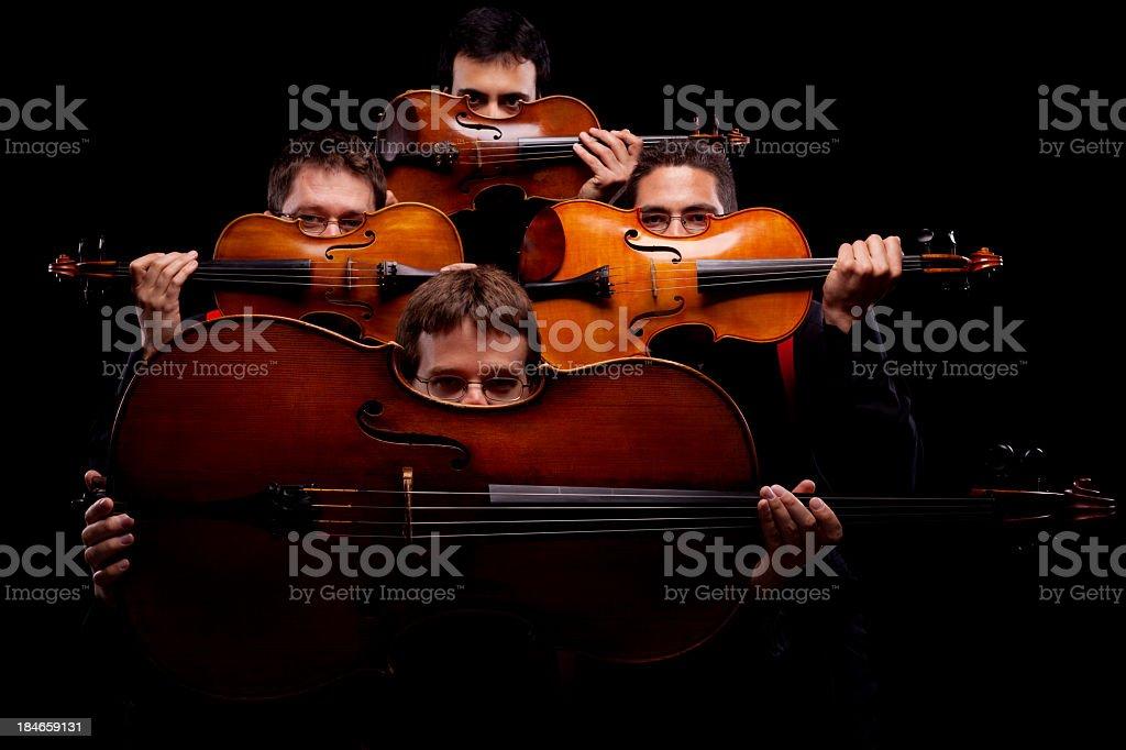 A string quartet on a dark background stock photo
