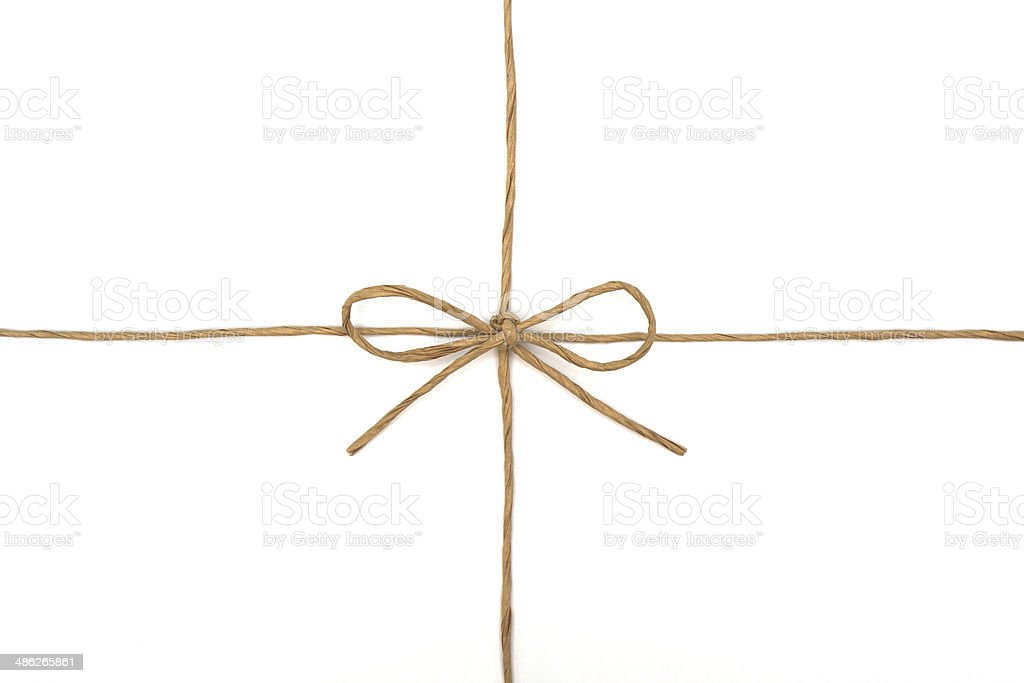 String tied in a bow on white stock photo