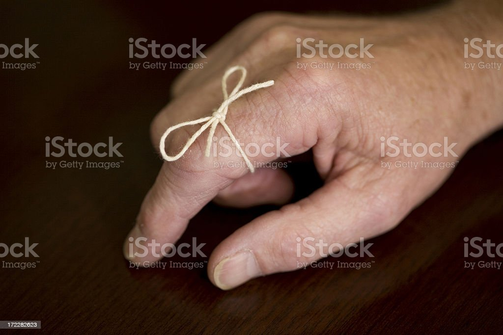 A string tied to a finger of a man stock photo