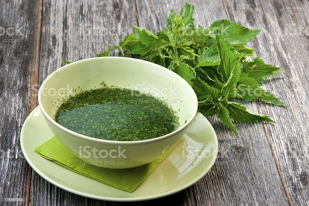 Stringing nettle soup stock photo