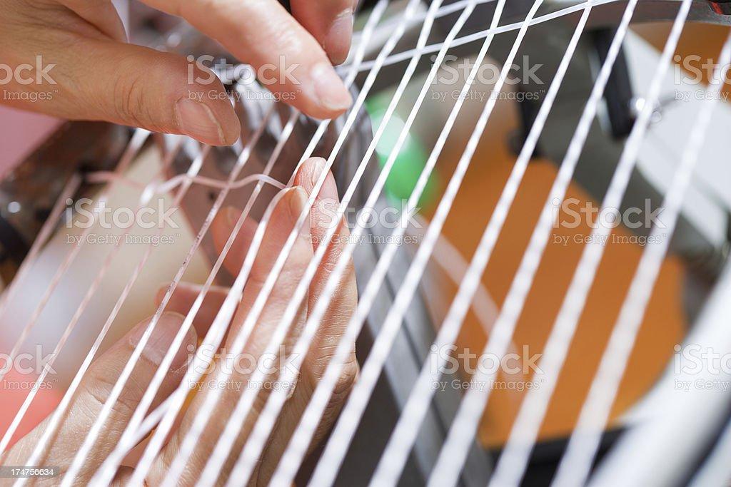 Stringing tennis racquet stock photo