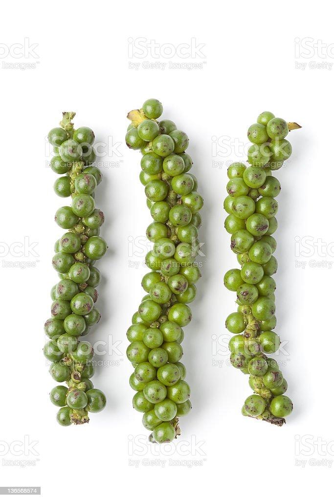 Strings of fresh unripe green pepper stock photo