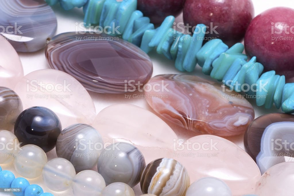 Strings of gem stones beds royalty-free stock photo