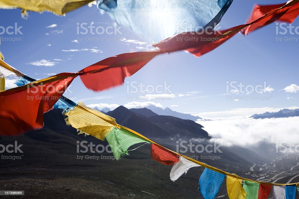 Strings of Tibetan prayer flags in different colors stock photo