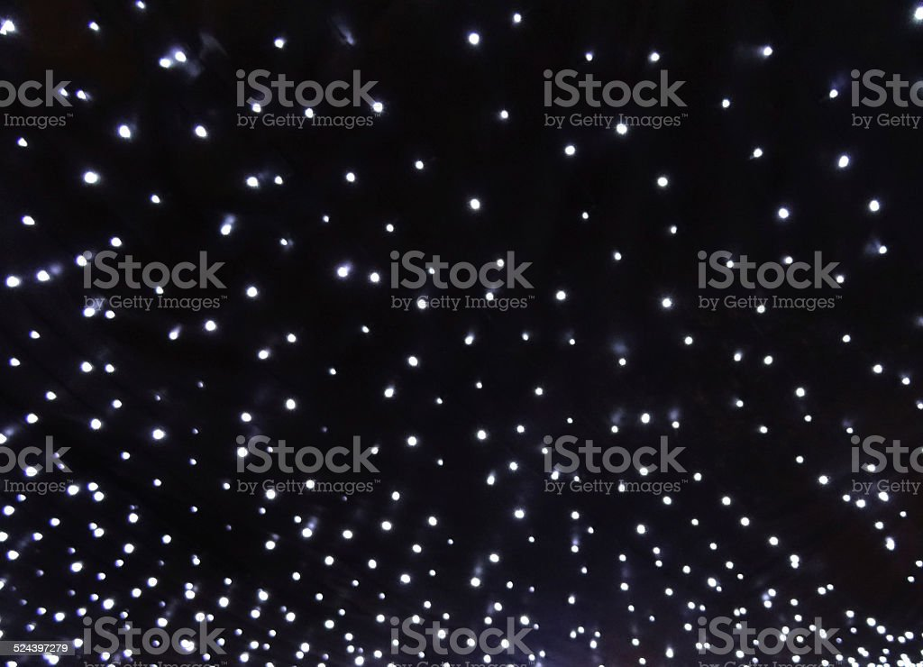 Strings of white Christmas lights background, LED fairy lights image stock photo