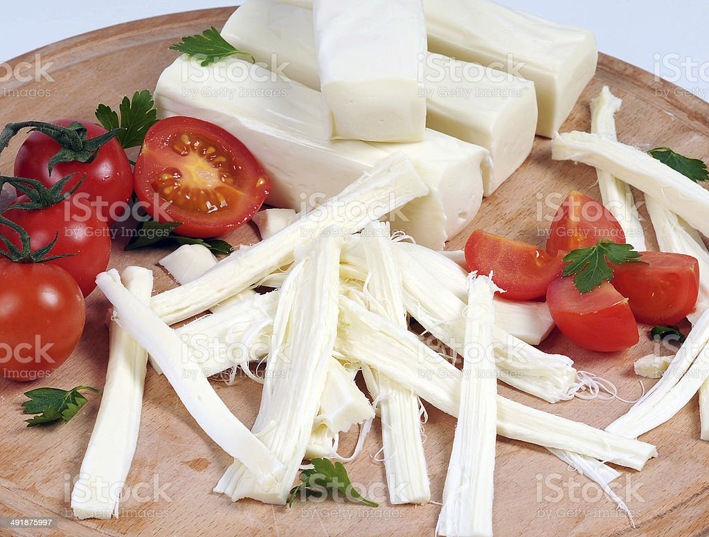 stringy cheese stock photo