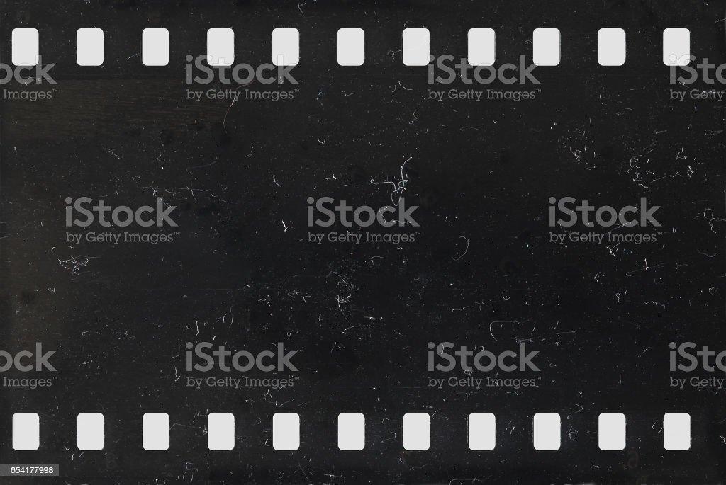 Strip of old negative celluloid film with dust and scratches stock photo