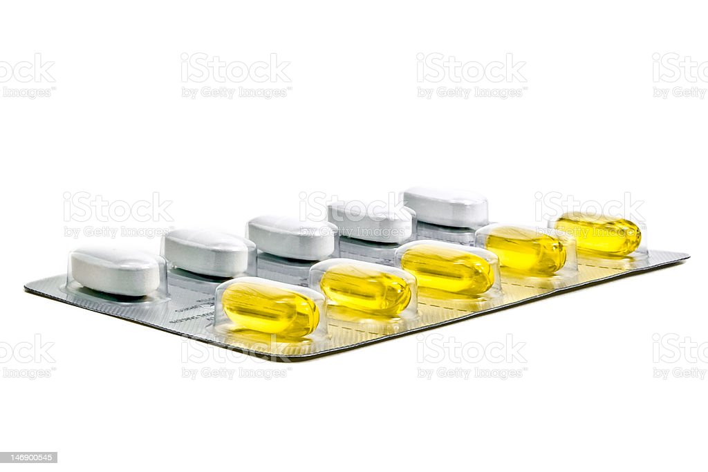 Strip of PreNatal Vitamins and Fishoil Tablets stock photo