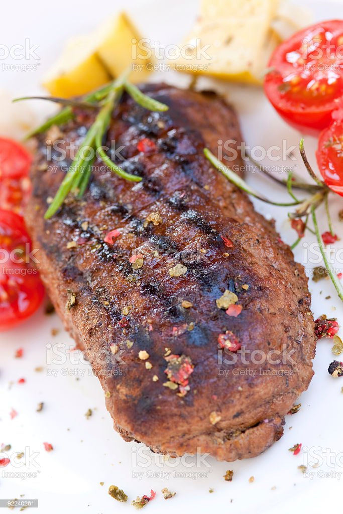 strip steak with cherry tomatoes royalty-free stock photo
