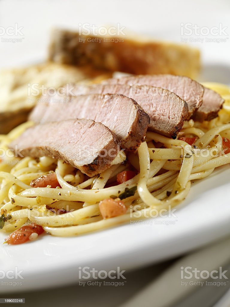 Strip Steak with Tomato and Herb Linguini royalty-free stock photo