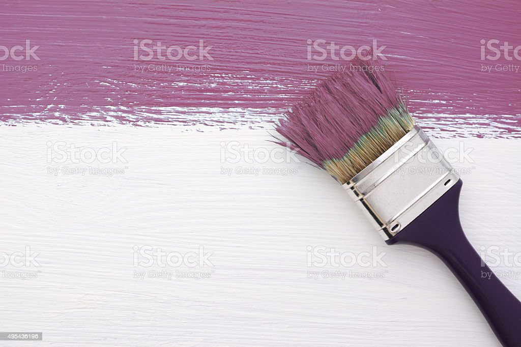 Stripe of plum paint with a paintbrush on white stock photo