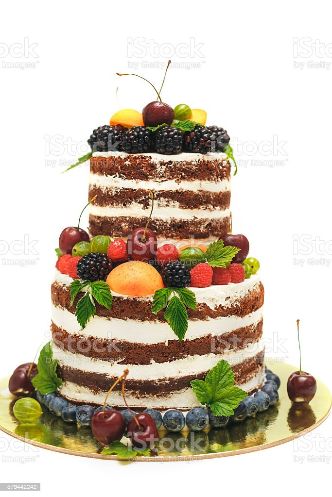 striped berry cake on white background stock photo