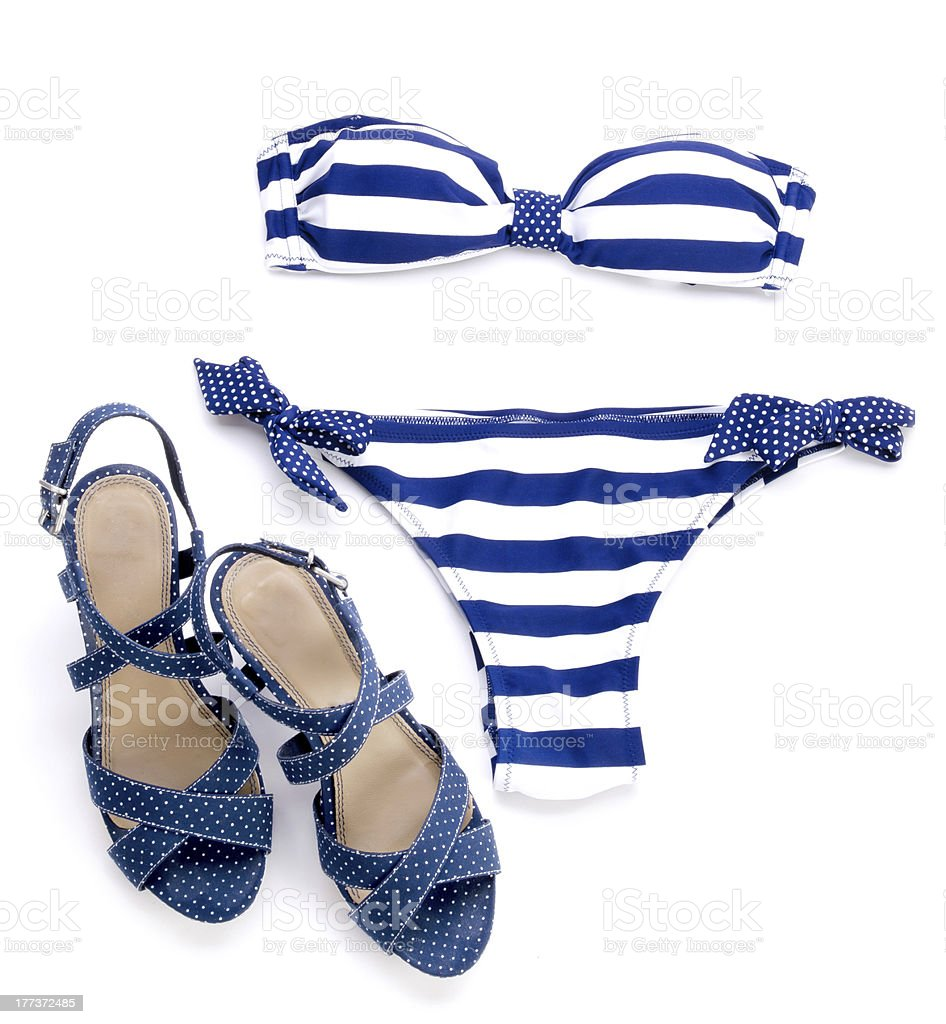 Striped bikini and spotted sandal stock photo