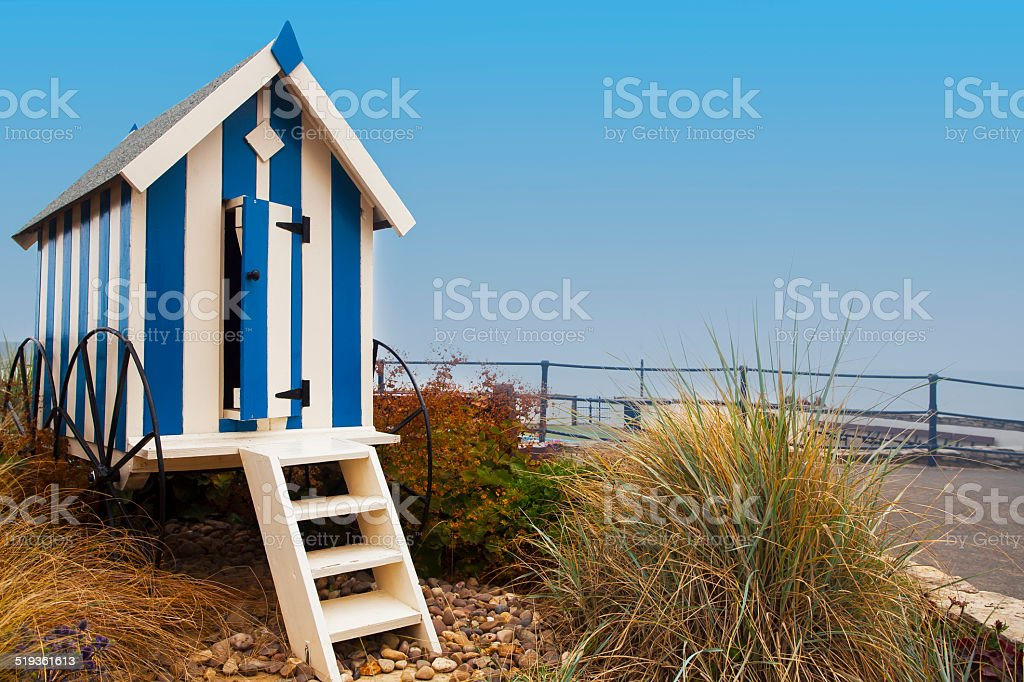 Striped blue beach hut on Filey promenade stock photo