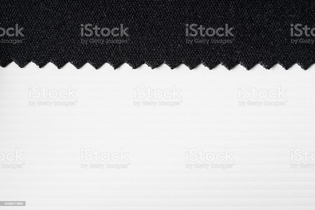 Striped embossed paper, fabric. White and black background. stock photo