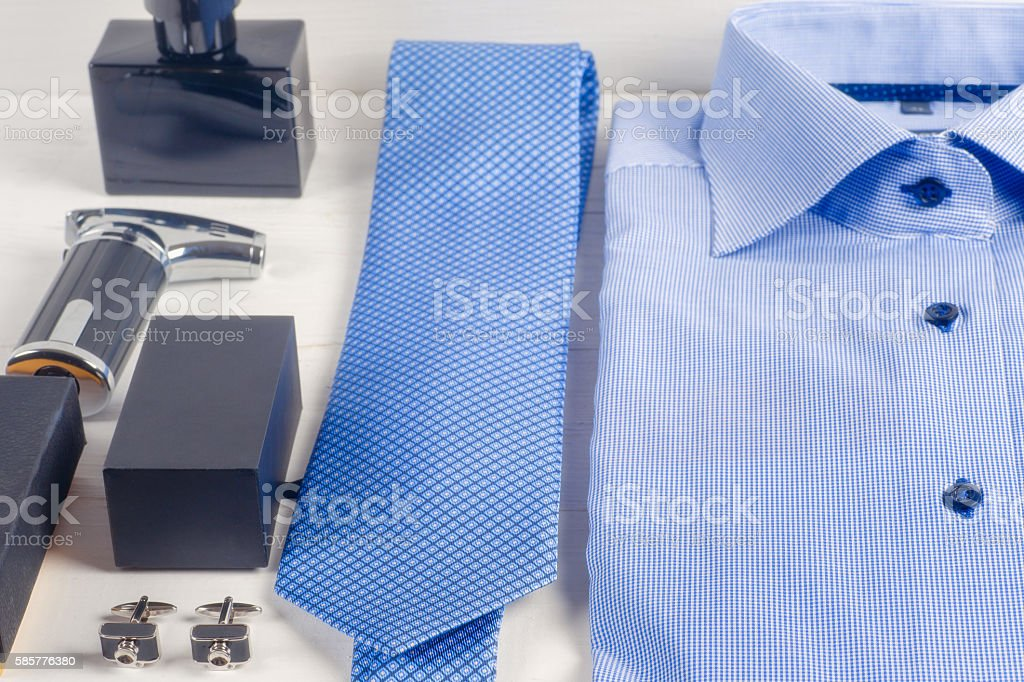 striped folded shirt with a tie isolated on white background stock photo