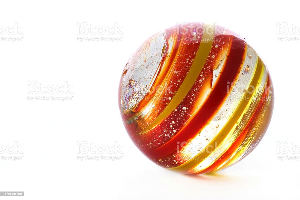 striped glass marble on white royalty-free stock photo