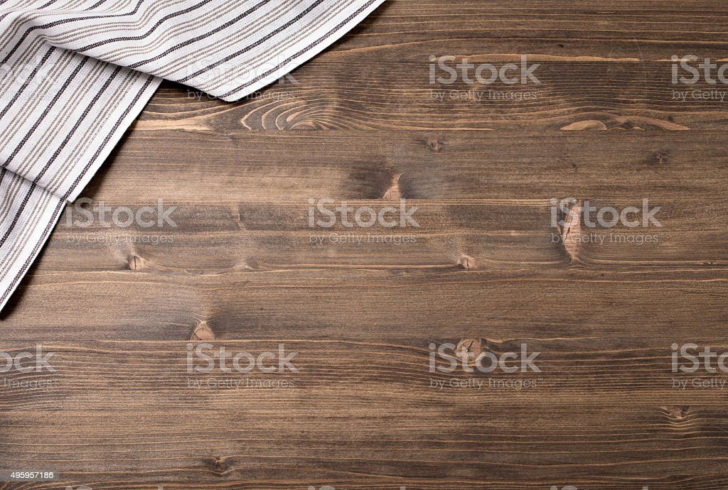 Striped kitchen towel on wooden table stock photo