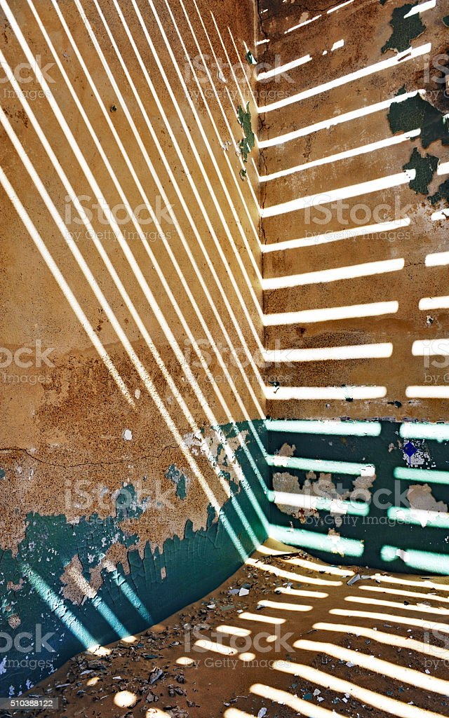 Striped light effect  in abandoned house in ghost town Kolmanskop,Namibia stock photo