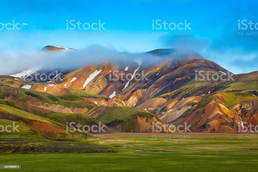 Striped mountains of rhyolite covered sunrise stock photo