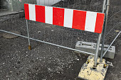 Striped red and white road barrier