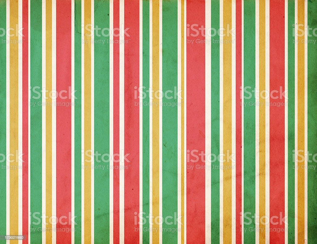 Striped red, green and gold colored retro Christmas paper royalty-free stock photo