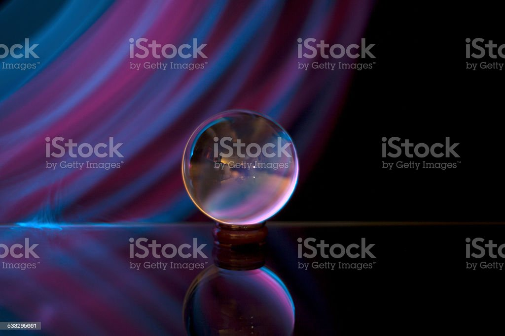 striped skies behind glass orb stock photo