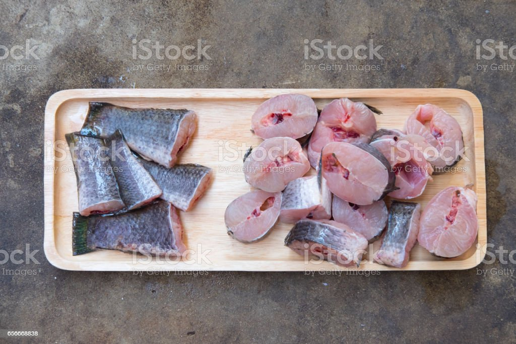 Striped snakehead fish chopped preparing for cooking on wood tray stock photo