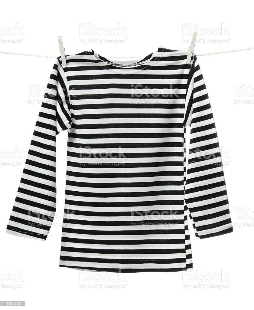A striped top pinned up on a washing line stock photo
