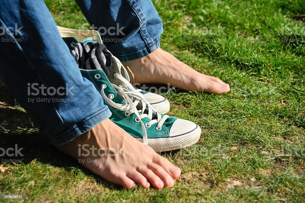 Stripped and barefoot shoes stock photo