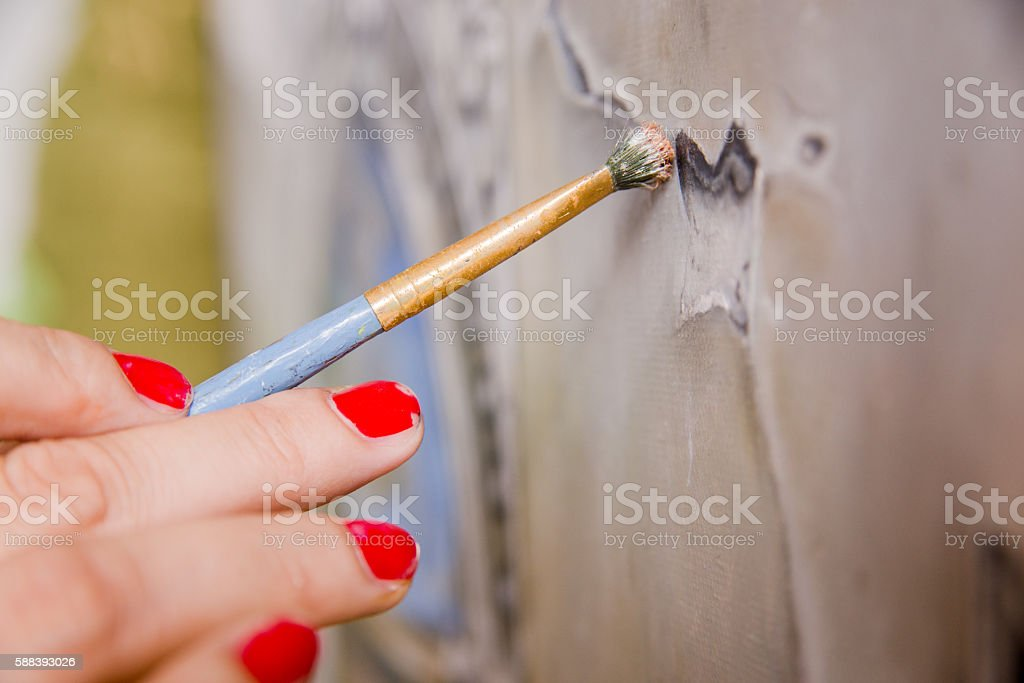 Stroke, Fine art painer holding a paintbrush stock photo