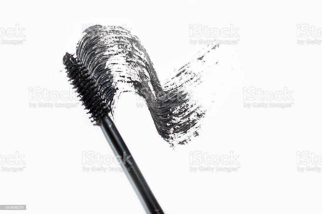 Stroke of black mascara with applicator brush stock photo
