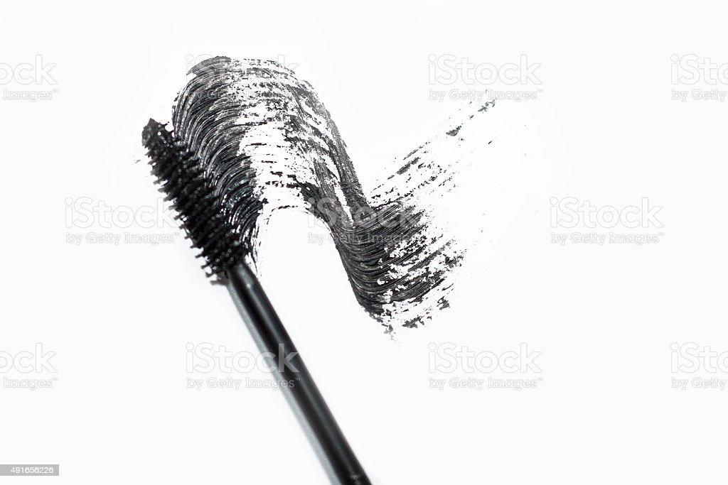 Stroke of black mascara with applicator brush stock photo