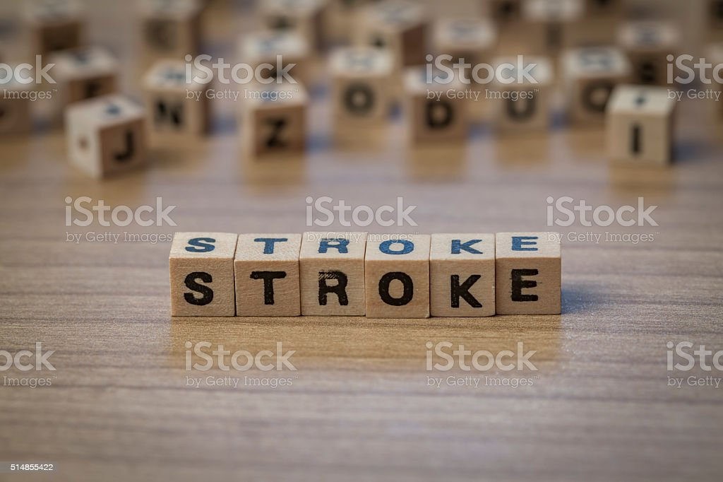Stroke written in wooden cubes stock photo