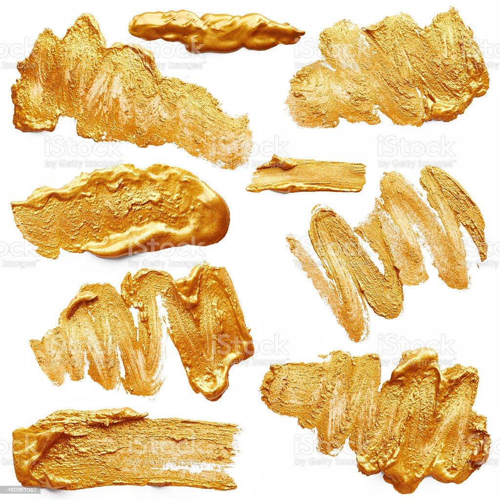 Strokes of golden paint stock photo