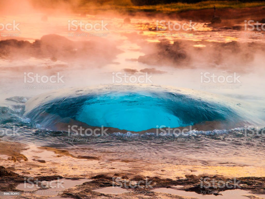 Strokkur geyser just at the explosion moment, Iceland stock photo